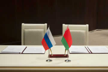 Belarus and Russia, a table for signing documents. Official documents for signatures, pens and flags of States on the table.